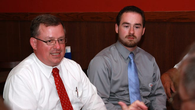 Emmett Township Supervisor Tim Hill and his son Jacob Hill wait for the results of Tuesday's primary. Tim Hill was seeking to win the Republican primary, while his son Jacob Hill sought the township's treasurer position.