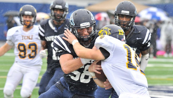 Wesley linebacker Mike Sabino makes a play on a College of New Jersey ballcarrier in the Wolverines' 41-0 win on Saturday.