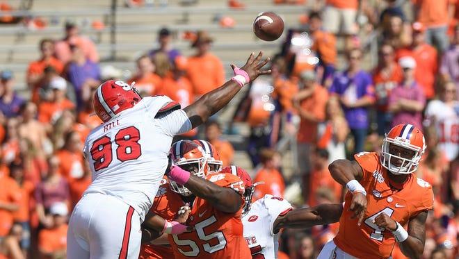 Clemson quarterback Deshaun Watson (4) passes against North Carolina State during the 2nd quarter on Saturday, October 15, 2016 at Clemson's Memorial Stadium.