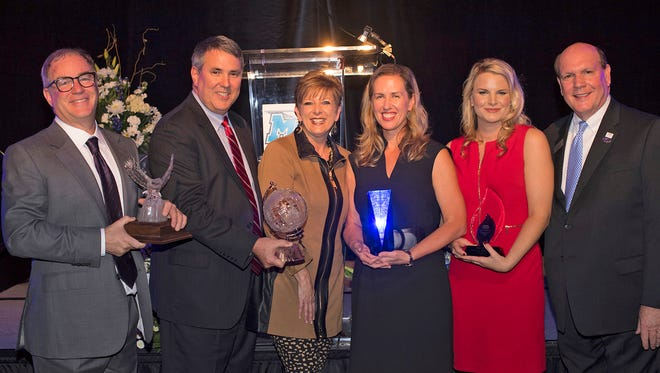The MTSU Jennings A. Jones College of Business formally recognized five honorees Oct. 27 during the 21st Century: Leaders That Matter awards ceremony at Embassy Suites Hotel and Conference Center. Pictured, from left, are Tim Downey, founder and CEO of Nashville-based Southern Land Co., recipient of the Joe M. Rodgers Spirit of America Award; David and Ann Hoke, both real estate professionals, recipients of the Jennings A. Jones Champion of Free Enterprise Award; Retta Gardner, president and CEO of Guaranty Trust Co., recipient of the Jones College Exemplar Award; Lorelei Samuelson, director of business intelligence for SME Solutions Group, recipient of the Young Professional of the Year Award; and David Urban, dean of the Jones College. (MTSU photo by Eric Sutton)