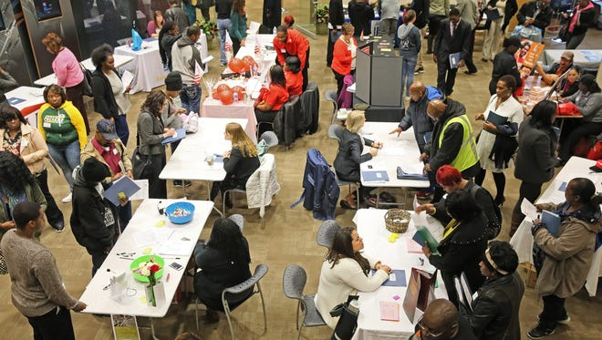 Prospective workers attend a recent job fair in MIlwaukee.
