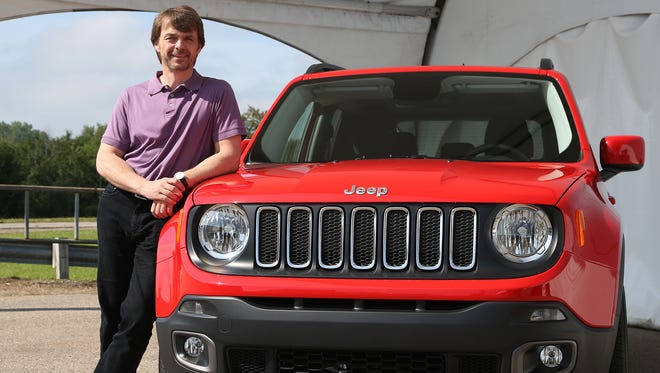 Mike Manley, head of the Jeep and Ram Brand, next to the all new 2015 Jeep Renegade that will be on showroom floors in 2015.