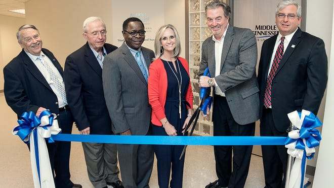 MTSU held an opening ceremony and luncheon Tuesday, Feb. 21, for the new Center for Student Coaching and Success on the second floor of the Miller Education Center on Bell Street. Cutting the ribbon, from left, are Harold Whiteside, dean of the College of Behavioral and Health Sciences, retired MTSU faculty member John MacBeth, MTSU President Sidney A. McPhee, Gina Floyd, John Floyd, and Colby Jubenville, director of the new center.