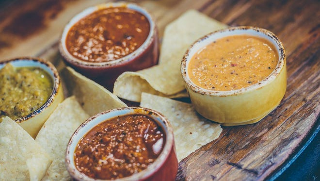 At Los Chingones in Denver, the Salsa Flight is presented with Chile Pasilla-Lime (medium), Chipotle Pineapple (medium) and Habanero (very hot) alongside tortilla chips.