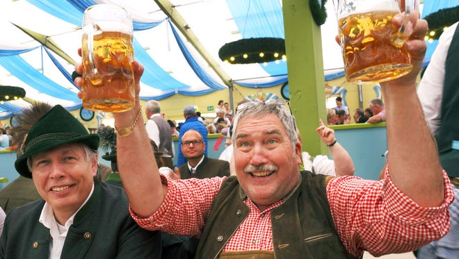 With Germany's best beers flowing by the liter at Oktoberfest, Bavarians are happy to toast with friendly foreigners.