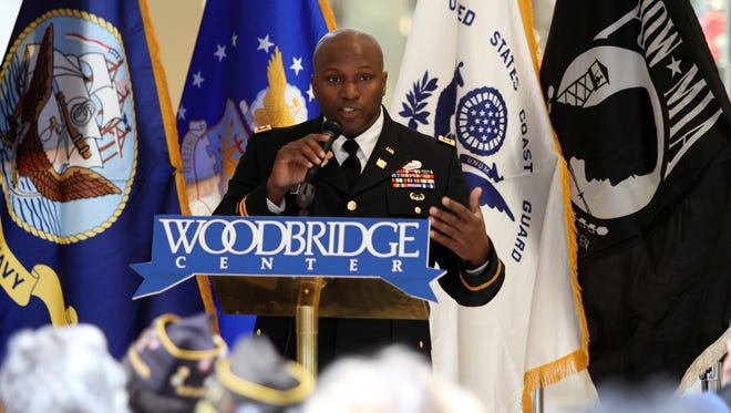 Col. Jemal Beale in shown speaking to veterans' families in this 2013 picture.