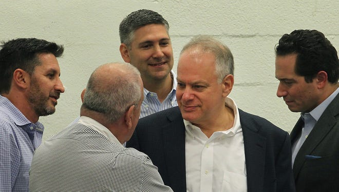 Stephen Bittel, center right, shown Dec. 20, 2016, at a meeting in Wynwood, Fla., ended his 10-month tenure as the head of Florida's Democratic Party after claims of inappropriate workplace conduct.