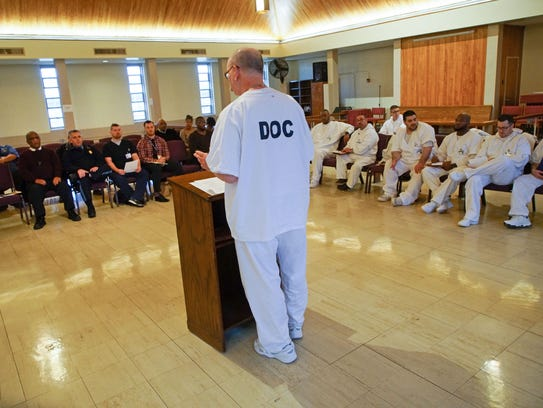 Specially chosen inmates representing different housing areas at James T. Vaughn Correctional Center speak to staff at an Inmate Advisory Committee meeting about ongoing issues they would like addressed while served time.