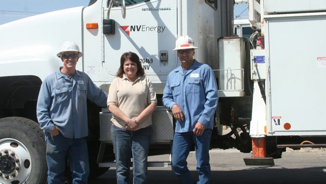 NV Energy has boosted local office staff. New staff here include, from left, lineman Jason Borsini, universal utilityperson Diane Eaton and line crew foreman Randy Menesini in front of a line crew truck at the Bridge Street yard. Not pictured is area service manager Marco Guerrero.