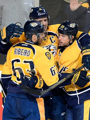 Predators center Craig Smith (15) celebrates with Mike Ribeiro (63) and Shea Weber (6) after scoring in overtime  Tuesday.