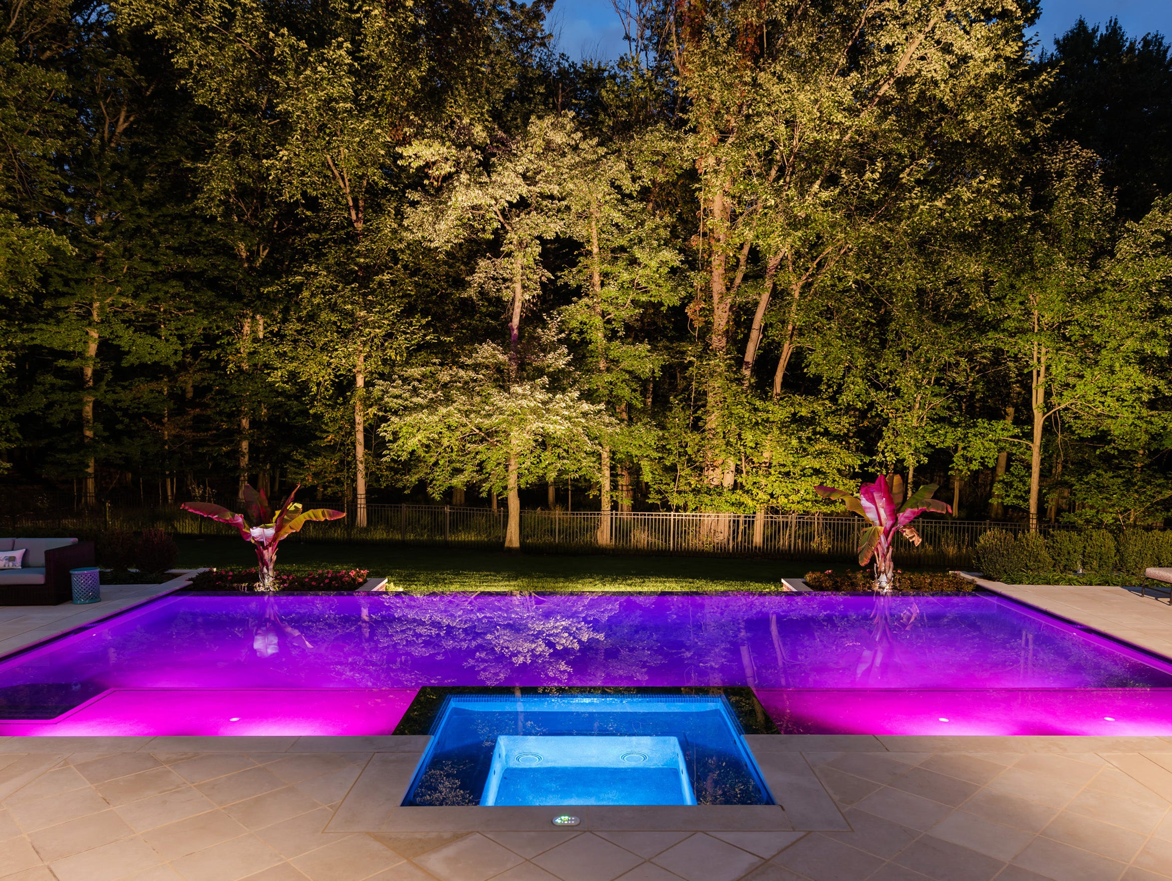 By day, these backyard beauties are serene and stylish but, come sundown, they shapeshift into sparkling spaces.