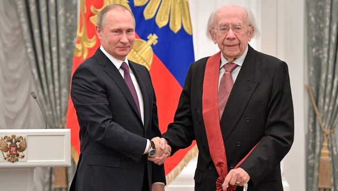 Russian President Vladimir Putin, left, presents a medal to conductor Gennady Rozhdestvensky during a state award ceremony in Moscow, Russia on May 24, 2017.