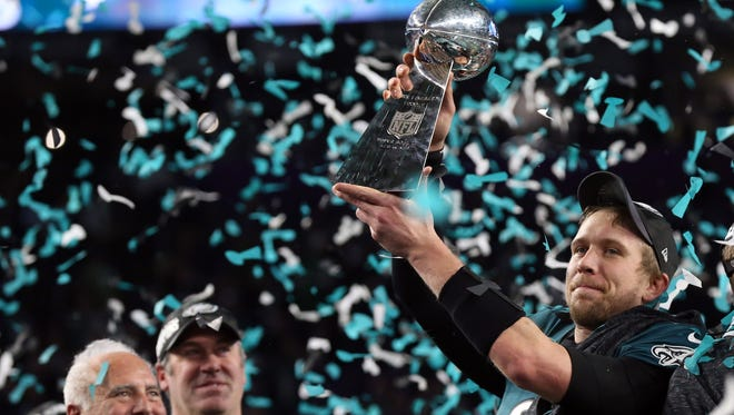 Nick Foles hoists the Lombardi Trophy after the Philadelphia Eagles defeated the New England Patriots in Super Bowl LII.