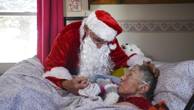 In this Saturday, Dec. 8, 2018 photo, Don West, 90, leans in to kiss his wife Jackie goodnight at Golden Days II Adult Foster Care in Charlotte following a Christmas party for residents and staff at the home.