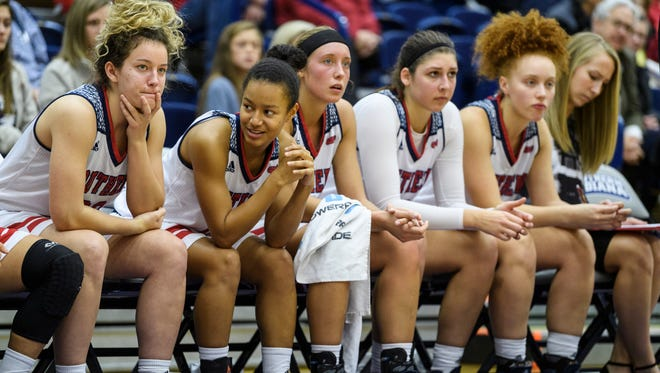 The USI Screaming Eagles watch their teammates take on the Lewis University Flyers from the bench during the fourth quarter at USI's Physical Activities Center in Evansville, Ind., Thursday, Nov. 30, 2017. The Screaming Eagles defeated the Flyers, 67-56.