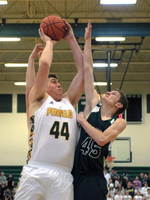 Pennfield's Ryan Lowe (44) drives to the basket against Olivet's Nicholas Johnson in the season opener on Tuesday.