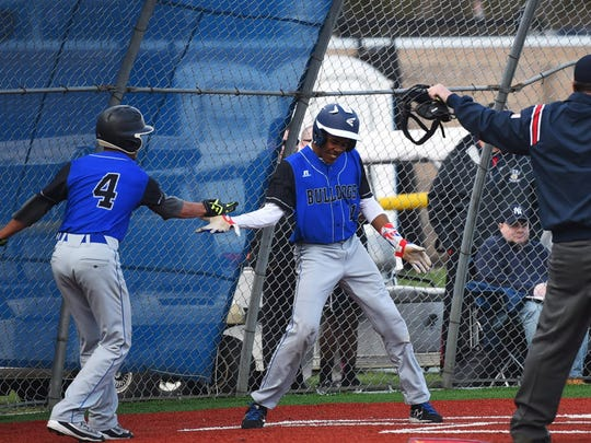 Arpert Cipion (right) had a home run and three RBI to help Passaic Tech win the Big North Liberty Division.