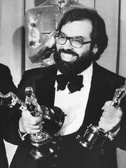 Francis Ford Coppola poses with his Oscar statuettes at the Academy Awards presentation on April 8, 1975.
