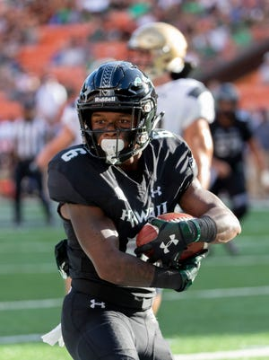 Hawaii wide receiver Cedric Byrd (6) cradles the football after catching it for a touchdown In the first half of an NCAA college football game against Navy, Saturday, Sept. 1, 2018, in Honolulu. (AP Photo/Eugene Tanner)