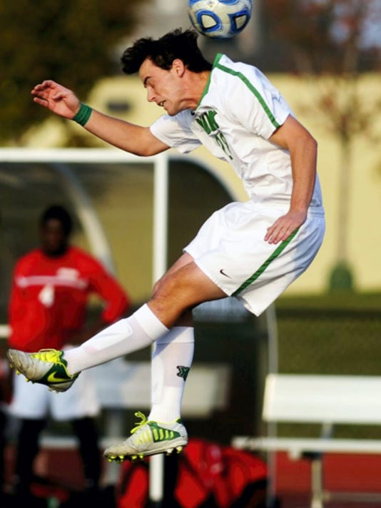 York College's Brendan Saberton heads the ball during a game in 2013. Saberton was one of four Spartan players who earned second-team Capital Athletic Conference honors last season.