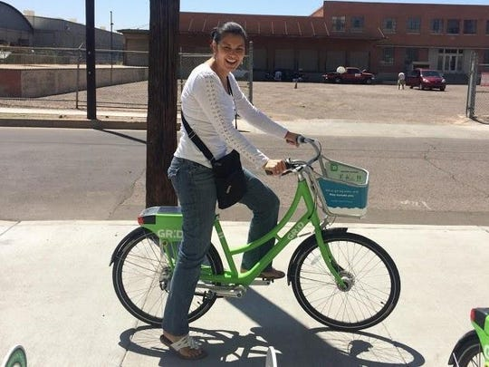 Heidi Jannenga, co-founder and chief operating officer at WebPT, is a frequent user of the Phoenix Grid Bike Share program. It costs her 67 cents to reach The Arrogant Butcher from her company's headquarters in the Phoenix Warehouse District.