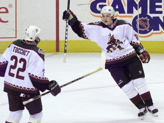 Coyotes center Daniel Briere celebrates a goal with
