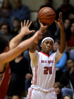 Richmond's Christian Harvey scores three points against Connersville Saturday, Dec. 17, 2016 during a basketball game in the Tiernan Center.