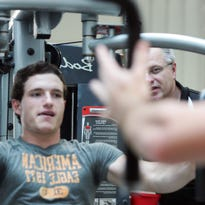 Shotie McClain, right, owner of Team Shotz, trains Levi Beckholt, a Newark High School senior and Generals hockey player, Tuesday at the 30th Street location.
