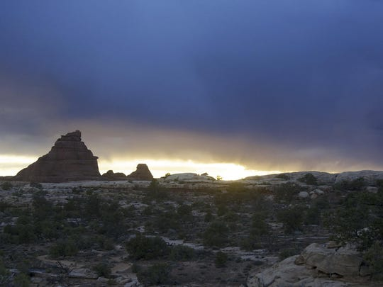 A spring storm darkens the skies and makes travel more difficult in Canyonlands, which is near Moab and Arches National Park.
