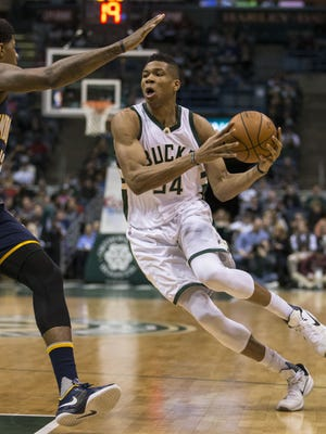 Milwaukee's Giannis Antetokounmpo puts a move on Indiana's Paul George during an NBA game on March 2.
