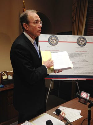 Mississippi Secretary of State Delbert Hosemann holds a folder of proposed election law updates that he is asking legislators to consider on Jan. 19, 2016 at the Mississippi Capitol in Jackson, Miss.