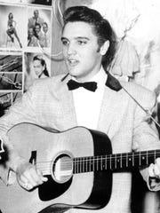 Elvis Presley in this 1956 file photo.
