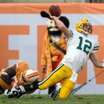 Packers quarterback Aaron Rodgers is sacked during the first quarter by Jimmy Wilkerson on Sept. 28, 2008 in Tampa, Fla.