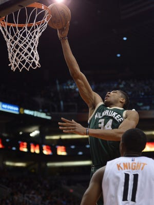 Bucks forward Giannis Antetokounmpo goes up for a layup against the Phoenix Suns in the second half Saturday at Talking Stick Resort Arena in Phoenix.