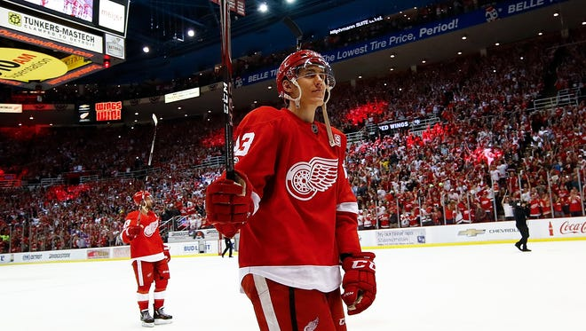 The Red Wings' Tomas Nosek celebrates and takes a lap around the ice after a 4-1 win over the New Jersey Devils at the final game at Joe Louis Arena on April 9, 2017.