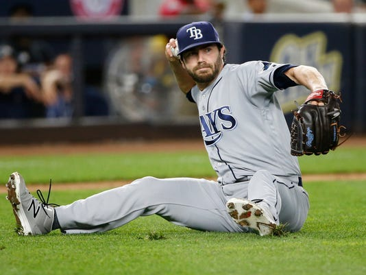 Tampa Bay Rays relief pitcher Austin Pruitt throws to first from the grass on a grounder by New York Yankees' Chase Headley during the eighth inning of a baseball game, Tuesday, Sept. 26, 2017. Headley was out. (AP Photo/Kathy Willens)