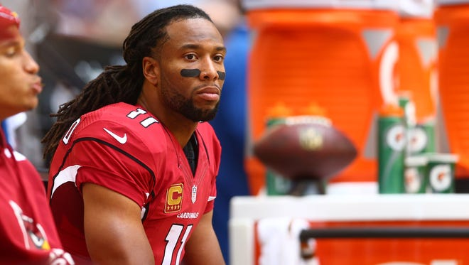 Cardinals wide receiver Larry Fitzgerald watches on the sidelines against the St. Louis Rams at University of Phoenix Stadium.