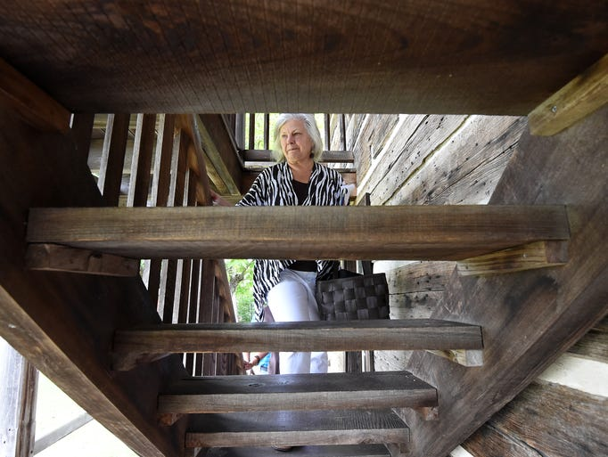 Dr. Ruth Hawkins, director of the Arkansas Heritage Sites with Arkansas State University Jonesboro, looks over the Wolf House in Norfork on Thursday, July 17, 2014. Hawkins visited the historic structure to see if it could be included in ASU's Arkansas Heritage Studies.