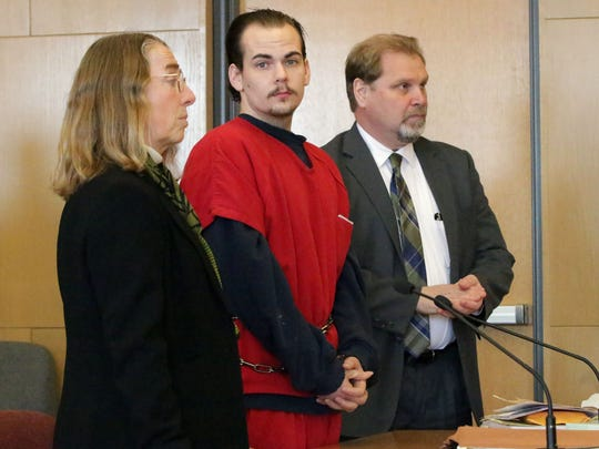 Defense attorneys Laurel Munger, left, and Jeffrey Haase, right, flank defendant Donovan Cotter Monday December 12, 2016 at Circuit Court Branch 5 in Sheboygan.  Cotter was convicted of killing a man with a knife over a $40 drug deal debt.