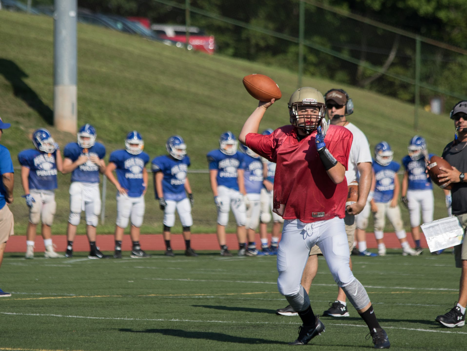Clarkstown South QB Matt Jung looks for an open receiver during a preseason scrimmage in West Nyack on Saturday. The Vikings hosted Pearl River, Nyack and Fox Lane.