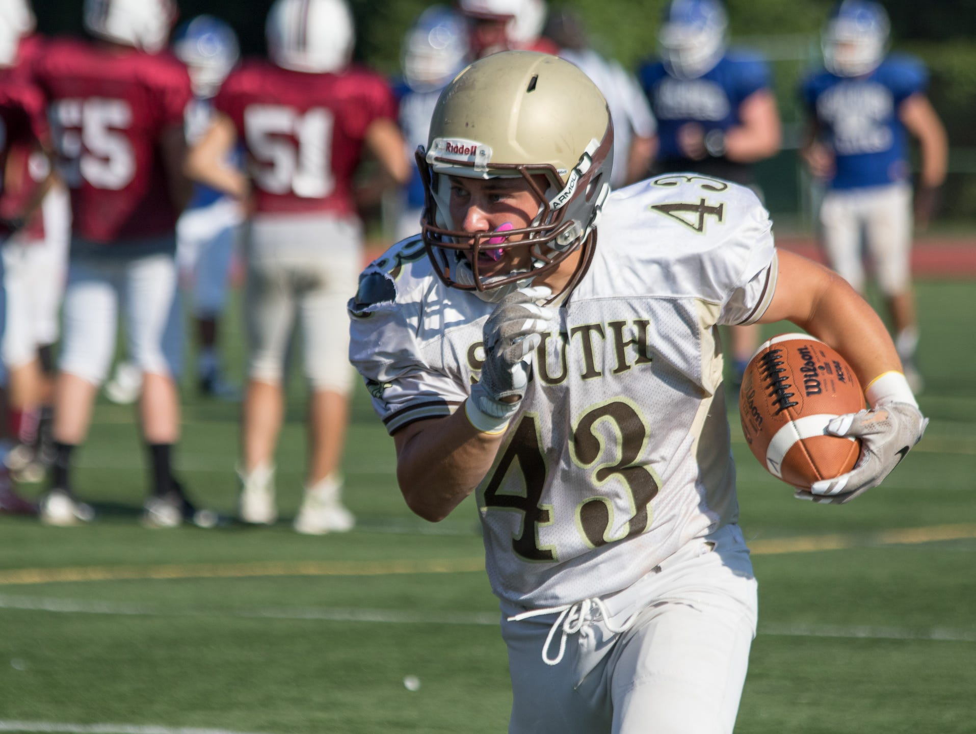 Clarkstown South's Ryan Thomas picks up yardage during a preseason scrimmage in West Nyack on Saturday. The Vikings hosted teams from Pearl River, Nyack and Fox Lane.
