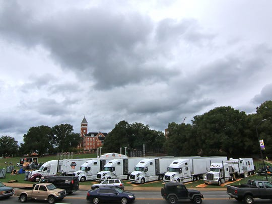 Six trucks with College GameDay Built By The Home Depot, are part of building a stage  on Bowman Field in Clemson.