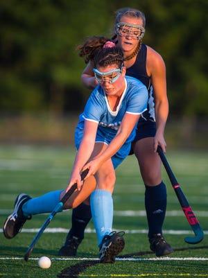 South Burlington's Joan Vera controls the ball against Mt. Mansfield's Abby Carter in South Burlington on Wednesday, September 27, 2017.