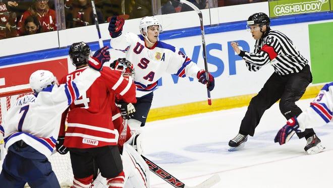 USA's Auston Matthews celebrates his 4-2 goal during the 2016 IIHF World Junior Ice Hockey Championship match between USA and Canada in Helsinki, Finland on Saturday.