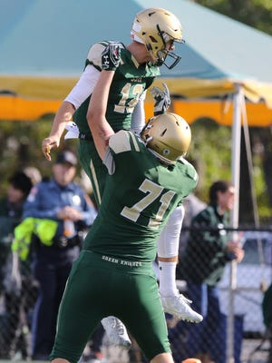 Nick Patti (12), here celebrating with offensive lineman Robert Martin during a game earlier this season, is playing the best he has all season as St. Joseph heads into the Non-Public Group 3 final against DePaul.