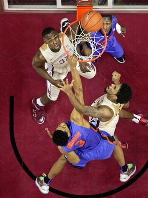 Dec 30, 2014; Tallahassee, FL, USA; Florida Gators forward Devin Robinson (3) scores over Florida State Seminoles forward Phil Cofer (0) in the first half at the Donald L. Tucker Center. Mandatory Credit: Phil Sears-USA TODAY Sports