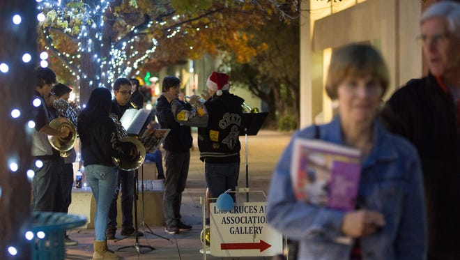 """The Oñate High School Brass Choir plays """"We Wish you a Merry Christmas,"""" on Main Street downtown Friday, December 2, 2016, as residents visit Plaza de Las Cruces and surrounding shops for the Downtown Las Cruces Merchants Association Holiday Open House"""