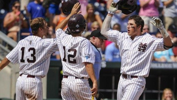 Mississippi State's Hunter Renfroe (right) celebrates with teammates Brett Pirtle (left) and Adam Frazier after hitting a three-run home run against Oregon State in the fifth inning at the College World Series in Omaha. Two years later, they're preparing for spring training.