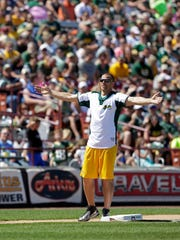 Jordy gets the crowd cheering for the next batter during the Jordy Nelson Charity Softball Game at Neuroscience Group Field at Fox Cities Stadium.