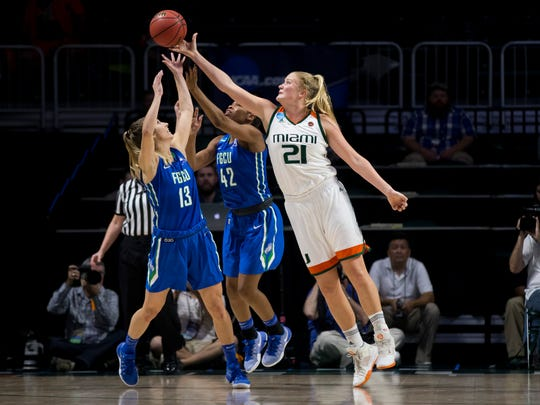 FGCU's Jordin Alexander (13) and FGCU's Tytionia Adderly (42) fight for a rebound against Miami's Emese Hof (21) during the first half of action during a first round NCAA tournament game at the Watsco Center Saturday, March 18, 2017 in Coral Gables, Fla.